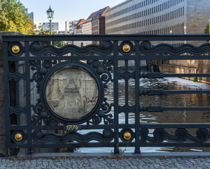 Decoration of the iron fence on the bridge over the Spree on Werderscher Markt in Berlin, Germany
