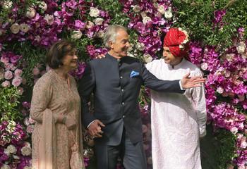 Former British prime minister Tony Blair, his wife Cherie and Anil Ambani, Chairman of the Reliance Anil Dhirubhai Ambani Group, pose during a photo opportunity at the wedding ceremony of Akash Ambani in Mumbai