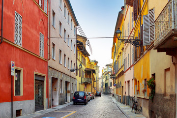 Old street with colourful houses in Parma, Emilia-Romagna,  Italy. Street view of architecture of Parma.