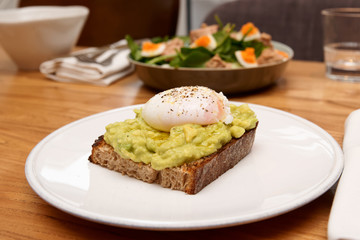 Grilled bread with guacamole and poached egg, tuna salad