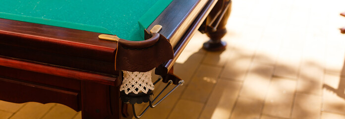 Snooker, Billiard or Pool game on green surface table, International sport, the hole on the green table.