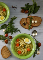 Rustic chicken soup with noodles and vegetables. horizontal view from above