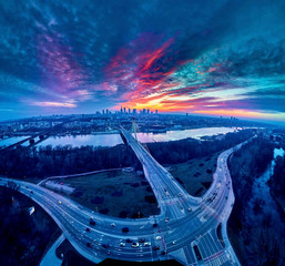 Beautiful panoramic aerial drone sunset view to Warsaw city center with skyscrapers and...