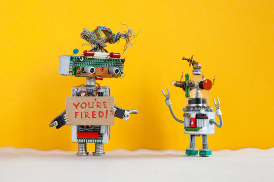 Robot chief dismisses younger robotic employer. Robotic character with a cardboard sign and handwritten text You are fired and small android dissatisfied with loosing vacancy. yellow background.