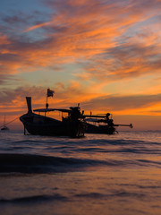 Wall Murals Shipwreck Long tail boat at sunset in Thailand