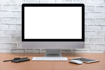 Blank screen of All in one Computer with tablet, smart phone and smart watch on wooden table, White brick wall background