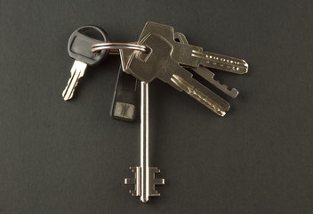 bunch of keys to the apartment on a black background