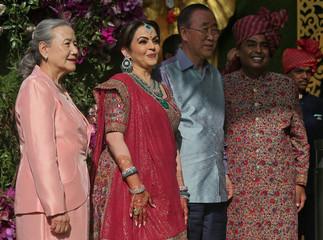 Former U.N. Secretary-General Ban Ki-moon, his wife Yoo Soon-taek, Mukesh, Chairman of Reliance Industries, and his wife Nita pose during a photo opportunity at wedding ceremony of Mukesh's son Akash Ambani at Bandra-Kurla Complex in Mumbai