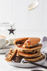 Pancakes stuffed chocolate on gray plate with coffee for breakfast.