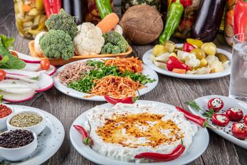 vegetable salad : green salad with raw tomato and garlic in white bowl radish, lemon, mint, tomato.