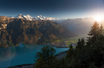 Idyllic view over Interlaken, Lake Brienz and the Swiss Alps during sunset, Eiger, Moench & Jungfrau, Bernese Oberland, Switzerland