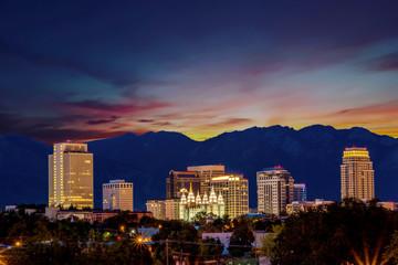 Fototapete - Sunrise over Salt Lake City with orange sky and street lights on