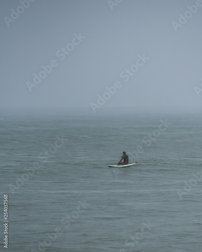 Surfing In The Rain Vacation Gone Wrong Stock Photo And