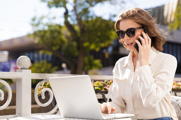 Confident young businesswoman using mobile phone