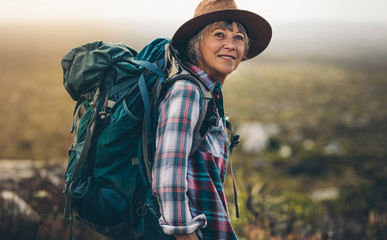 Portrait of a woman hiker Wall mural