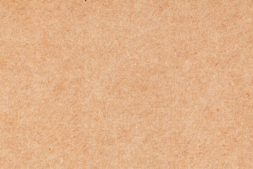 Sheet of paper brown cardboard. Texture closeup, natural rough textured paper background.