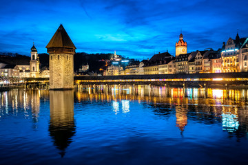 Wall Mural - Lucerne, Switzerland, the Old town and Chapel bridge in the late evening blue light