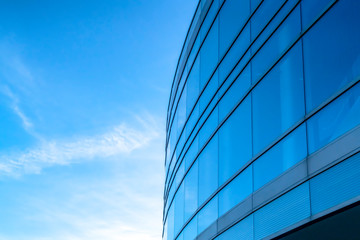 Building exterior with bright blue sky background Wall mural