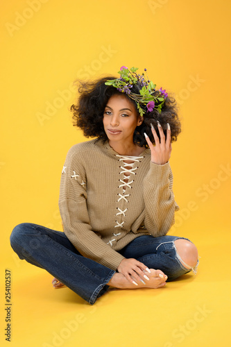 70's Style Soul Sister Black Woman on a Yellow Background