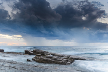 Clouds, Rock Ledge and Early Morning Seascape