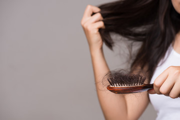 Healthy concept. Woman show her brush with long loss hair and looking at her hair. Fototapete