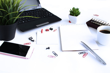 A business man's Desk-a laptop, a notebook and a Cup of coffee. With red elements.