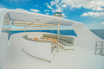 Table and chairs on sundeck of a luxury motor yacht