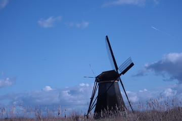 windmill of kinderdijk , beautiful netherlands landscape with sky and clouds background, historical travel photo