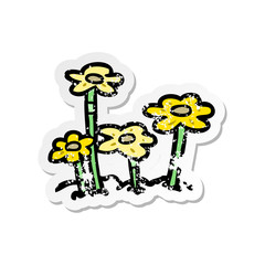 distressed sticker of a cartoon flowers
