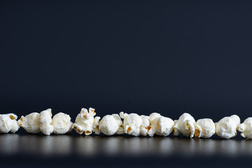 Dark studio setting with popcorn as subject