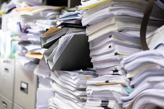 Many filing cabinets in a messy office without mess.