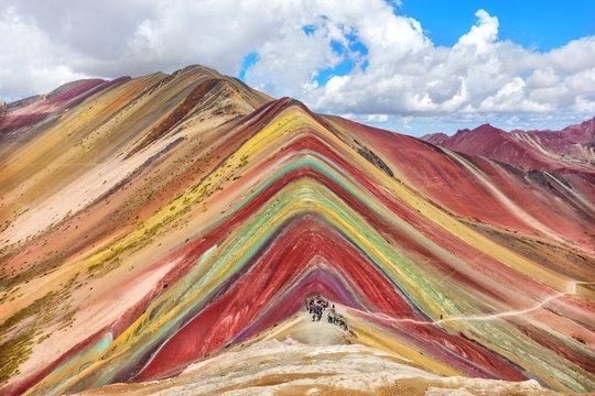 Unidentified  tourists walking on the Rainbow Mountain, Peru.