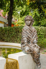 Moraholom, Hungary - September 06, 2014: Bronze statue at the fountain in Morahalom, Hungary