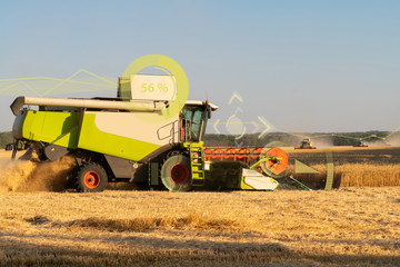 Wall Mural - A modern combine harvester harvests wheat using a head-up display and the Internet of things in agriculture.