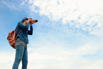 Female photographer in high view.