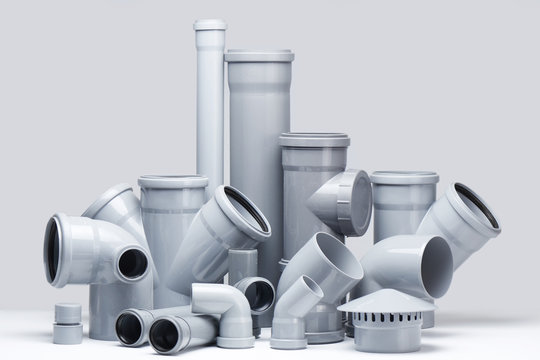 Plumbing, sewage. Gray polypropylene tubes on a white background in futuristic style