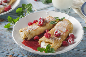 Cheese blintzes pancakes with fresh fruit