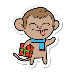 sticker of a funny cartoon monkey with christmas present