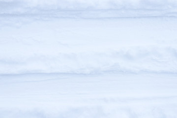 Ski traces on the snow background. Winter snowy texture. Fresh frozen backdrop.