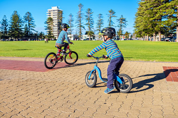 Children riding bicycles in Glenelg
