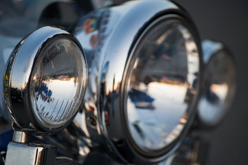 Chromed motorcycle headlights close up