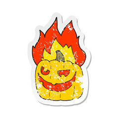 retro distressed sticker of a cartoon flaming halloween pumpkin