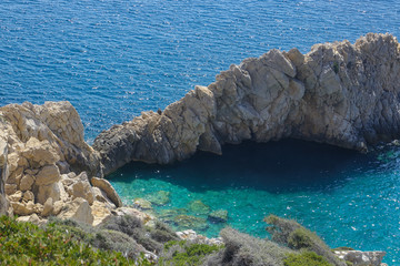 Aluminium Prints Cyprus rugged rock cliff at Prioni beach, Ikaria, North Aegean island
