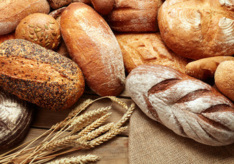 Door stickers Bread assortment of baked bread on wooden background