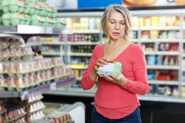 woman shopping for eggs in food department