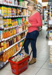 Mature woman choosing refreshing drinks