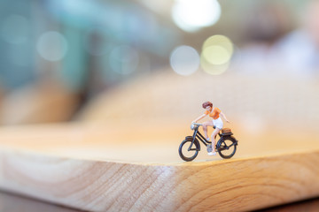 Miniature people  cycling on wooden bridge , Health care concepts Wall mural