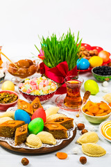 Autocollant pour porte Pique-nique Colored eggs, wheat springs and sweet pastry for Novruz Holiday in Azerbaijan on White Background. Selective focus.