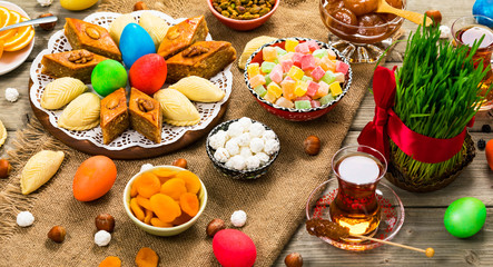 Colored eggs, wheat springs and sweet pastry for Nowruz Holiday in Azerbaijan. Selective focus.