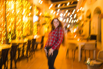 Nightlife, party and lifestyle concept - Girl walking in night city, soft focus and blurred